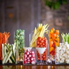 Instead of a vegetable platter…why not create a stunning table display with all your favorite veggies! Check the dollar stores for cheap cylinder glass vases.all different sizes…The dip in the martini glasses is a brilliant idea! Appetizer Display, Appetizer Buffet, Appetizers Table, Crudite Platter, Veggie Platters, Vegetable Tray Display, Vegetable Trays, Fresh Vegetables, Veggies