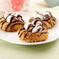 A great kid-friendly thumbprint cookie coated with graham cracker crumbs and filled with chocolate and marshmallows.
