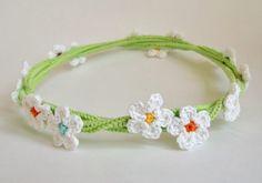 Crochet flower girl headband. hair accessory flower girl, birthday girl, fairy costume. White flowers on a green vine.. $22.50, via Etsy.