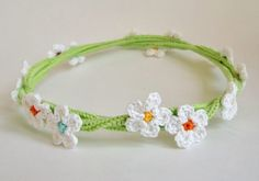 Crochet flower girl headband. hair accessory flower girl, birthday girl, fairy costume. White flowers on a green vine.. $22.50, via Etsy.