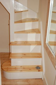 The white risers and wooden treads look fresh and natural.