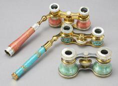 Guilloche, mother-of-pearl and enamel pairs of opera glasses.