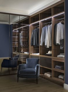 The ultimate contemporary walk in wardrobe: Bronze Reflex Mirror Doors with Walnut Internals
