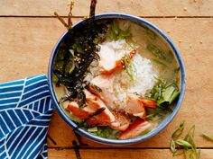 Glazed Salmon Miso Soup Rice Bowl : Though serving up a fish dinner for the whole family may not sound like the most fiscally responsible move, breaking out of the one-fillet-per-person mindset makes it doable. This satisfying miso-based soup stretches just a half-pound of salmon to feed four people. At only two ounces of fish per person, you may be able to spring for the ocean-friendly wild-caught variety.