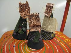 Fourth graders have been learning about Africa in Art class. We practiced making African masks and African textile designs and combined those ideas to make our African sculptures!