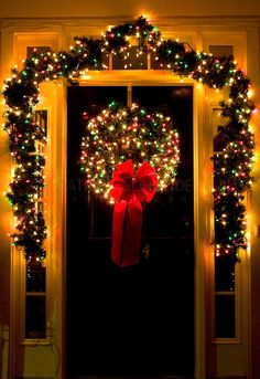 Christmas lights glow on a front door in the town of McAdenville, NC.