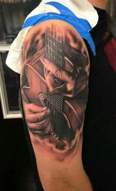 What does guitar tattoo mean? We have guitar tattoo ideas, designs, symbolism and we explain the meaning behind the tattoo. Wicked Tattoos, Dad Tattoos, Music Tattoos, Future Tattoos, Body Art Tattoos, Tattoos For Guys, Tatoos, Faith Tattoos, Music Tattoo Sleeves