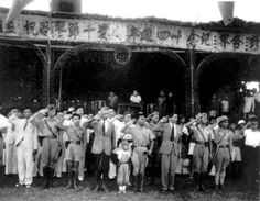 Viet Minh and Laotian officials on November 1, 1945, reviewing a parade of troops of the Chinese Nationalist 93d Division in Vientiane. Prince Souphanouvong, commander in chief, Lao Issara forces, is in uniform in the front row, next to his young son Aryia.
