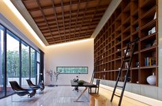 """The study belongs to house """"B3"""", one of the 20 houses in a residential project by Atelier FCJZ. The built-in library unit is very majestic and you can feel an Asian influence behind it and the whole interior in general. What is most striking about this room is the decision to continue the library pattern onto the ceiling"""