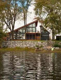 Even though this is an exterior, I love the shape of this cabin and the glass that reflects the trees and water
