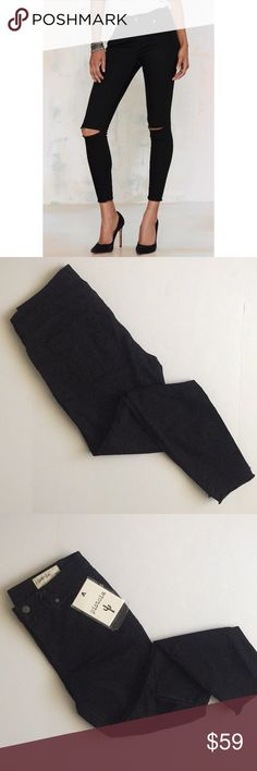 """Black distressed skinny jeans Pistola by Nasty Gal Black skinny jeans perfect to rock with a tee and pumps. Slit in both knees and frayed hem.   Measurements are approximate (flat lay): Waist- 14.5"""" Hips-17"""" Rise- 9.5"""" Inseam- 26""""  Brand: Pistola sold by Nasty Gal NWT Nasty Gal Jeans Skinny"""