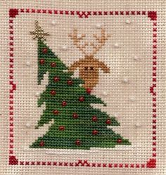 Christmas cross stitch - reindeer peek-a-boo. Cross Stitch Christmas Ornaments, Xmas Cross Stitch, Cross Stitch Love, Cross Stitch Needles, Christmas Embroidery, Christmas Cross, Counted Cross Stitch Patterns, Cross Stitch Charts, Cross Stitch Designs