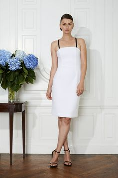e077d147356a6 The perfect designer little white sheath dress for a bride to wear to a  rehearsal dinner