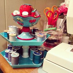 Lots of talk about trays lately on IG so I thought I'd share my little homemade, tiered thread holder. Remember those little hexagonal plastic trays from the Target Dollar Spot a while ago? I bought two, glued them together with two empty spools of thread in between, and topped them with the little Mary Engelbreit footed bowl I got at Salvation Army--new, still in the box! It's bright, cheery and super handy!