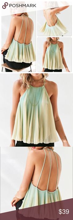 "Urban outfitters pleated swing blouse M Brand new with tags. From brand kimchi blue of urban outfitters. Sleeveless pleated high neck swing cami with super strappy. Accordion pleated shift on with chic loose fit. Polyester. Chest 36"" length 34""  Urban Outfitters Tops Blouses"