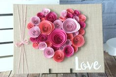 Easy Valentine's Day craft. Glue paper flowers to a burlap canvas in the shape of a heart. Spiral Flower Heart craft.