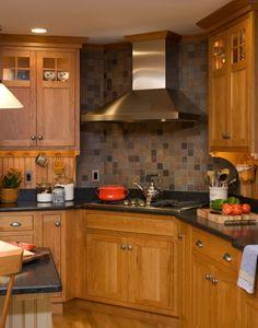 Contrast of charcoal counters, oak cabinets & slate backsplash?  Look ~ there's even some beadboard backsplash, too!