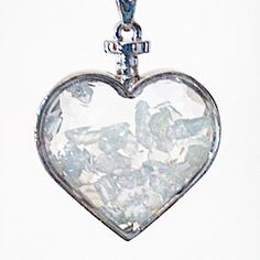 "A stunning new way to wear natural crystals and gemstones. Our Aquamarine Chip Glass Heart Pendant Necklace is strung on a 20"" Sterling Silver chain necklace, and features Genuine Aquamarine gemstone chips in a heart shaped prism cut glass with a silver plated frame.  Aquamarine Brings Calm, Communication, Courage, and Self-Healing  Pendant size approx.  1.25"" x 1.5"" 20"" Sterling Silver chain necklace  Packaged in a pretty black Organza bag great for gifting!"