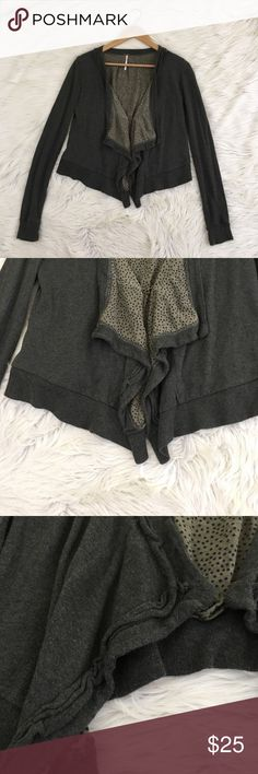 Free People Wool Blend Grey Draped Shrug Cardigan Free People Women's XS Wool Blend Shrug/Cardigan • Hood and eye closure • Grey • polka dot interior • Raw edge/Distressed look • excellent condition no flaws  Length: Armpit to armpit:  📌NO lowball offers 📌NO modeling 📌NO trades  I will try to respond to inquiries in a timely matter. Please check out the rest of my closet, I have various brands and ALL different sizes. Some new with tags, others in excellent condition😊 Free People…