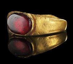 Golden ring with a garnet. Roman, 3rd century A.D.