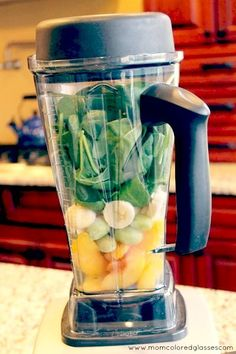 Ingredients:    2 generous handfuls of spinach or green leafy vegetable of your choice  1 banana sliced  2 cups of frozen fruit (I used 1 cup frozen green grapes and 1 cup of frozen peaches for this recipe; berries and cherries also taste great in green smoothies)  1/2 – 3/4 cups of water