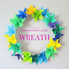 Origami paper flower wreath Origami Paper or cut your own Paper into Squares   Floral Wire or Coat Hanger  Masking Tape Sticky Tape Scissors  ~See Video to make Origami Flowers ~