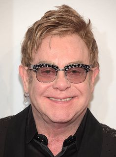 Elton John Photos - Founder Sir Elton John attends the Elton John AIDS Foundation's Annual An Enduring Vision Benefit at Cipriani Wall Street on October 2014 in New York City. - Annual An Enduring Vision Benefit George Michael, Round Sunglasses, Mens Sunglasses, Elton John Aids Foundation, Donny Osmond, Billie Joe Armstrong, Concert Tickets, American Music Awards, Rock Legends