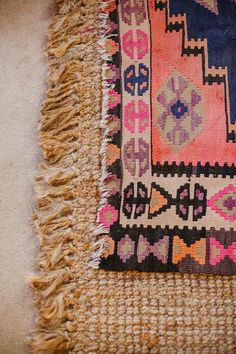 Layered rugs give texture and color to any room