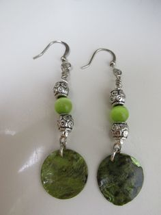 A personal favorite from my Etsy shop https://www.etsy.com/listing/268256272/dangle-earrings-with-green-shell-and