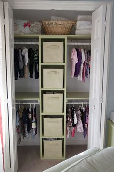 Kids closet, similar to our idea except actual drawers instead of bins and only half way up, and then curtains instead of doors