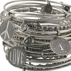 This set of 21 Signature Expandable bangles is sure to make a sexy statement on your wrist. Featuring 10 plain bangles, 3 bangles adorned with charms, and 8 bangles embellished with metal smooth oval, ribbed, dotted ball and cylindrical beads. The charms
