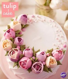Surprise the mom in your life with this stunning Tulip Cake for Mother's Day! Beautiful buttercream tulips make this cake also perfect for spring! There is even room on the cake to personalize it, if so desired.