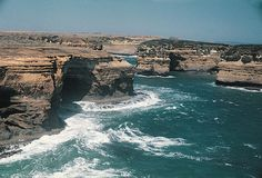 The cliffs, rocky outcrops and powerful waves indicate this coastline in Port Campbell in southern Australia is a high energy shoreline.