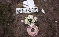 Flowers are placed on the grave of an unidentified migrant, who drowned at sea during an attempt to cross a part of the Aegean Sea from the Turkish coast, at the Saint Panteleimon cemetery of Mytilene, on the Greek island of Lesvos, October 7.