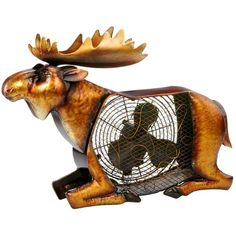 Art Fans - Let this Moose Shaped Decorative Figurine Fan brighten your day while it keeps you cool. With its decorative appeal, a Figurine Fan can easily become a permanent part of any desk, vanity, bedroom, kitchen, or bathroom decor.