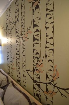 Close up of the hand painted birch trees over the headboard.
