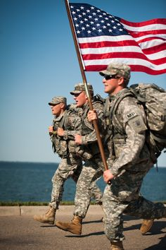 United States Military men holding our flag with pride.