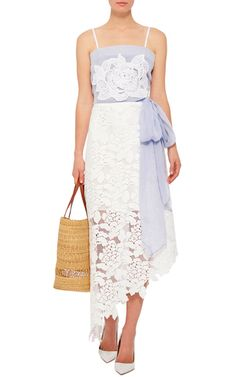 https://www.modaoperandi.com/lila-eugenie-r16/cotton-silk-voile-flower-wrap-top?utm_source=criteo