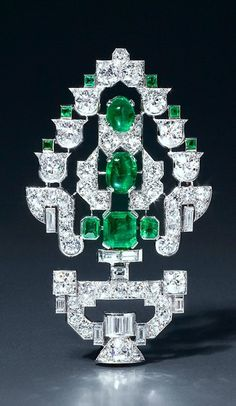 EMERALD and diamond tree brooch,  old Colombian emeralds and baguette cut and old brilliant cut diamonds, mounted in platinum and 18 karat gold. Paris, 1934.