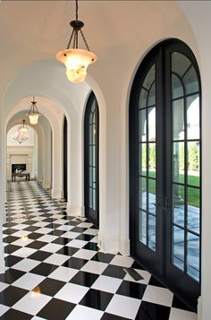 This is for your foyer, but I am looking at a bigger tile so it won't be as busy. The black doors look terrific!