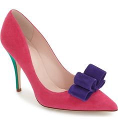 Swooning over these color-blocked pumps by Kate Spade. A purple bow underscores a playful style.