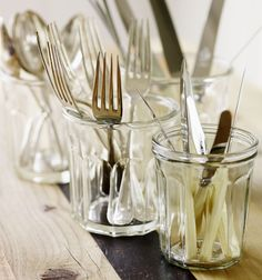 Antique cutlery in clear glass jars