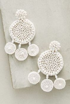 Add a statement to your look with earrings from Anthropologie. Discover our collection of unique hoop, drop, chandelier, cluster and post earrings for women. Beaded Clutch, Beaded Earrings, Statement Earrings, Crochet Earrings, Tree Jewelry Holder, Jewelry Tree, Jewellery Diy, White Earrings, Drop Earrings
