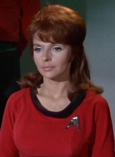 """Lieutenant Marla McGivers was the historian aboard the USS Enterprise, however she rarely had active duties to perform. In 2267, the Enterprise discovered the SS Botany Bay and Khan Noonien Singh, a dictator who had ruled much of Earth in the 1990s. When Kirk banished Khan and his followers to Ceti Alpha V, McGivers opted to accompany them rather than face a court-martial. Khan was pleased by her choice and dubbed her """"a superior woman."""" (TOS: """"Space Seed"""")"""
