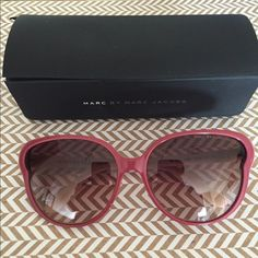 Marc by Marc Jacobs Sunglasses Preowned Marc by Marc Jacobs Sunglasses  The glasses are in good condition  There is a tiny scratch on the left lens that wouldn't even show on the pics   Colored frames Moulded nose pads for added comfort Dark tinted lenses Contrast arms with curved temple tips for a secure fit Total UV protection  Come with case and cleaning cloth  The case lid is ripped as shown in pic 4  Open to reasonable offer through the offer button Marc by Marc Jacobs Accessories…