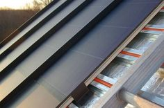 Solar Sandwich roof system. On the surface, it looks like any other standing-seam metal roof with columns of thin-film photovoltaic solar. Yet below that, to capture the warmth generated from hot metal roofing, there's a grid of pex-filled purlins with a water and glycol solution for a solar thermal system.