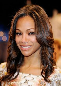 Zoe Saldana wore her long hair in feathered waves at the 2012 Independent Spirit Awards cocktail party.