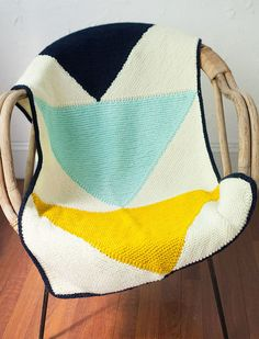 Free Knitting Pattern for Flying Geese Baby Blanket - The traditional stacked triangle quilt design interpreted in a modern color block knitting pattern. 24 x 36 inches but you can make it larger by knitting more triangle panels or more than one strip. Designed by Purl Soho. Pictured project by KPJenny