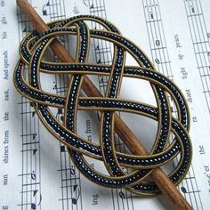 Sailor's Ladder-Step Knot Barrette: this gorgeous hair accessory was made from recycled guitar strings and a mix of navy and black beads