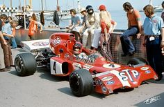 Niki Lauda in an STP March at Monaco. Looks like James Hunt in the back with he black helmet.